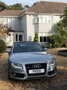 """Picture of Greg's car on the drive at Talbot Physiotherapy Clinic with numberplate """"Pyzio"""""""